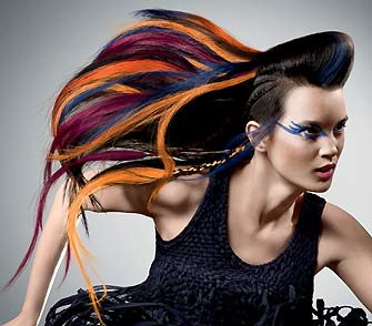 fig.: Nomad Couture is inspired by the effects of modern mobility. Different inspirations come together to create new things that transcends cultural and regional barriers. A life without limits that opens up new perspectives that go beyond our imagination.The hair has a structured cut that is showcasing a mix of different textures and styles in one look. The colors are reflecting a rainbow of bright, neon color, reddish brown tones, hot bright accents.